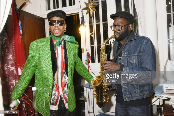 Singer Robby the Lord and saxo Mezz attend Zelia Van Den Bulke Aprons show At Zelia Abbesses Shop on May 1, 2018 in Paris, France.