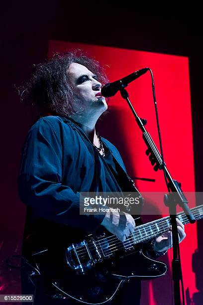 Singer Robert James Smith of the British band The Cure performs live during a concert at the MercedesBenz Arena on October 18 2016 in Berlin Germany