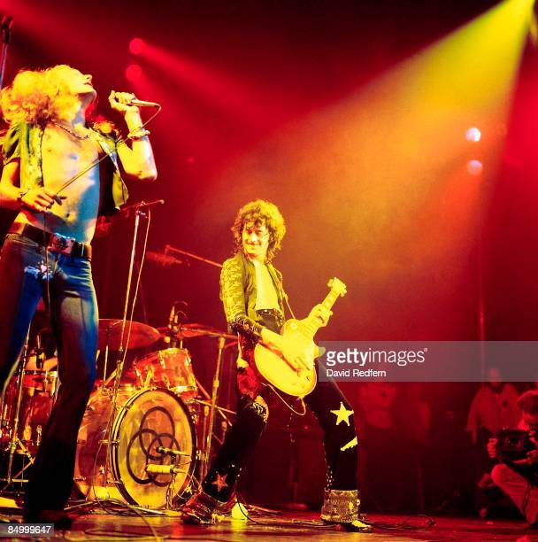 Singer Robert Plant and guitarist Jimmy Page, playing a Gibson Les Paul Standard guitar, perform live on stage during a concert by English rock band...