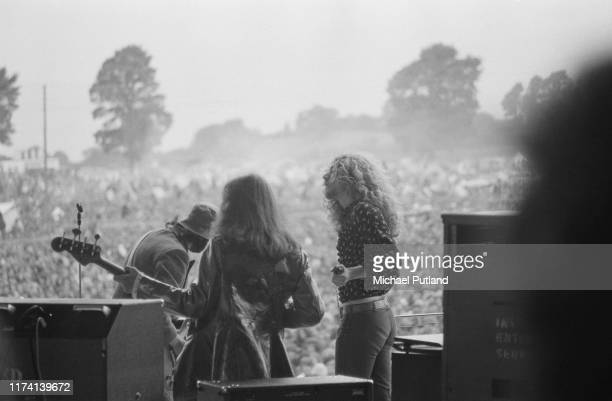 Singer Robert Plant guitarist Jimmy Page and bass guitarist John Paul Jones of British rock group Led Zeppelin performing together on stage at The...