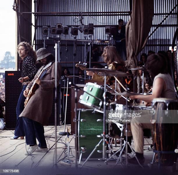 Singer Robert Plant, guitarist Jimmy Page, bassist John Paul Jones and drummer John Bonham of British rock band Led Zeppelin performing on stage at...