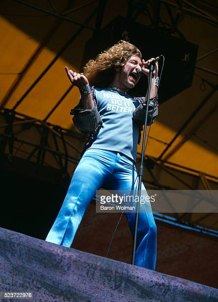 Singer Robert Plant of English rock band Led Zeppelin performs at the Day on the Green Oakland Coliseum Oakland California July 1977