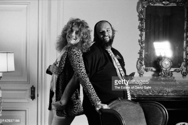 Singer Robert Plant of rock group Led Zeppelin and Led Zeppelin manager Peter Grant pose for a portrait on May 7 1974 in New York City New York