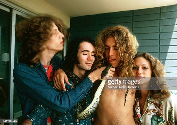 Singer Robert Plant of the rock band 'Led Zeppelin' poses for a portrait with tour members BP Fallon and Vanessa Gilbert and the snake man on a...