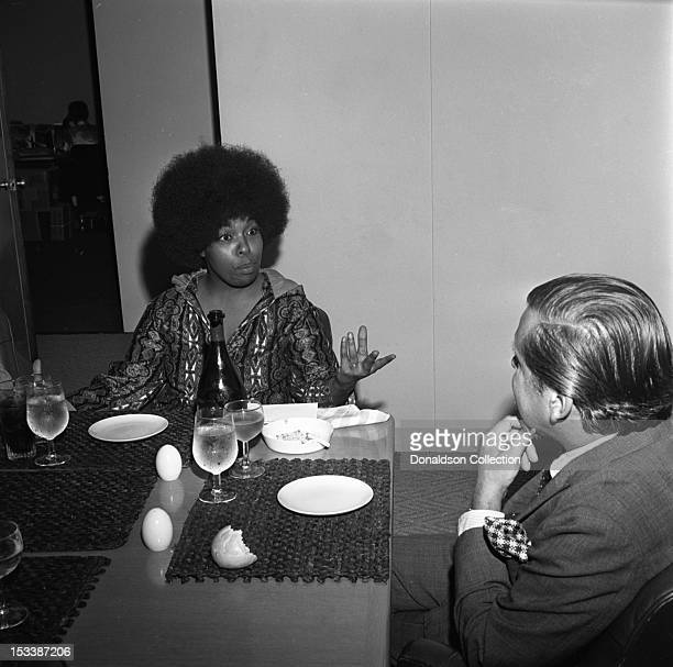 Singer Roberta Flack and Atlantic Records executive Nesuhi Ertegun during a luncheon to celebrate her signing to Atlantic Records on August 4 1970 in...