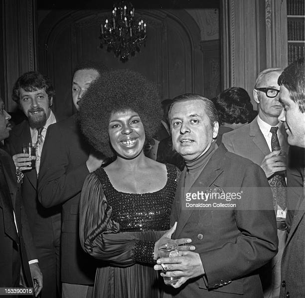 Singer Roberta Flack and record executive Nesuhi Ertegun at an Atlantic Records party in her honor at the St. Regis Hotel on November 17, 1969 in New...