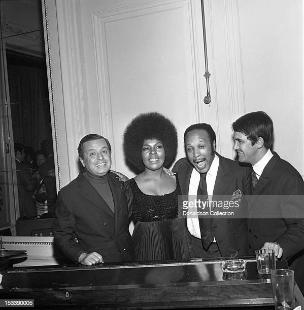 Singer Roberta Flack, record executive Nesuhi Ertegun and party guests at an Atlantic Records party in her honor at the St. Regis Hotel on November...