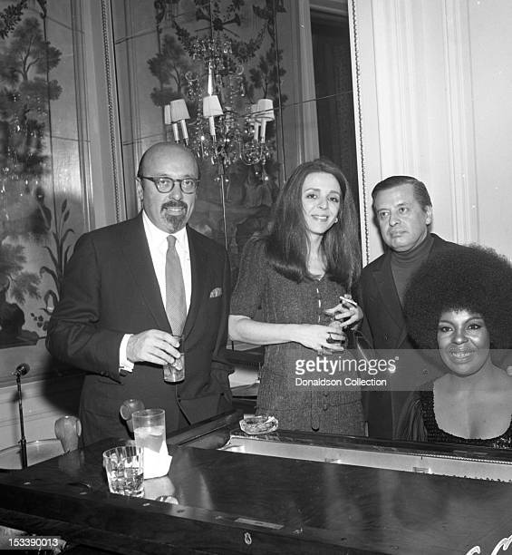 Singer Roberta Flack, record executives Nesuhi Ertegun and Ahmet Ertegun and party guests at an Atlantic Records party in her honor at the St. Regis...