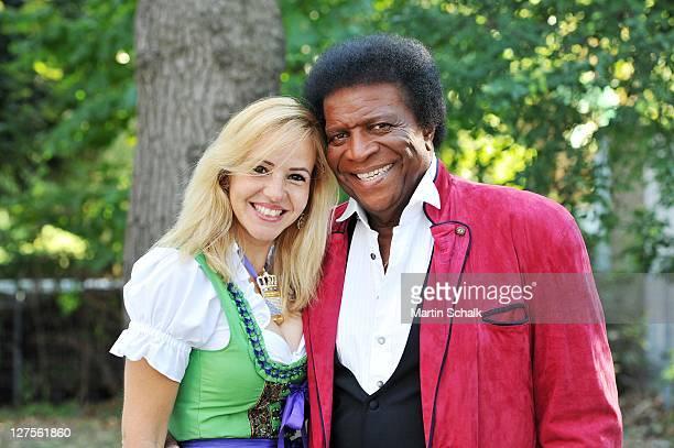 Singer Roberto Blanco and Luzandra Strassburg attend the 'Wiener Wiesn' Vienna Oktoberfest on September 29 2011 in Vienna Austria