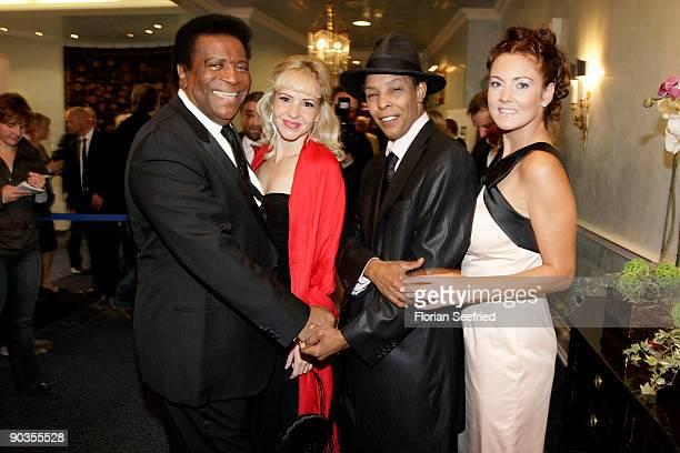Singer Roberto Blanco his girlfriend Luzandra Strassburg singer Marla Glen and wife Sabrina Conley attend the 'UNICEFGala' at Park Hotel on September...