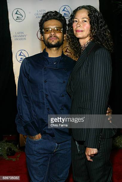 Singer Robi Draco Rosa and video director Angela Alvarado Rosa arrive at the 2004 Latin Recording Academy 'Person of the Year Tribute Event Honoring...