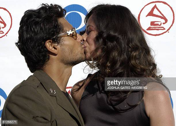 Singer Robi Draco Rosa shares a kiss with his wife and video director Angela Alvarado Rosa at the 5th Annual Latin Grammy Awards at the Shrine...