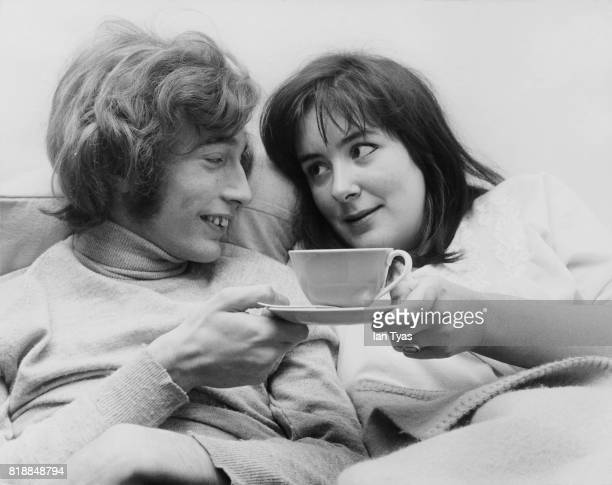 Singer Robin Gibb of the Bee Gees drinking tea with his fiancee Molly Hullis 1968