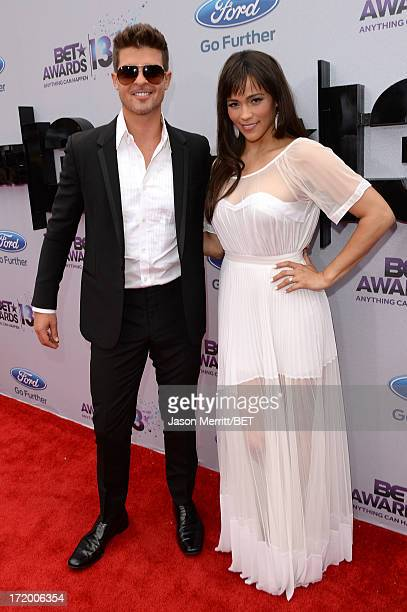 Singer Robin Thicke and actress Paula Patton attend the Ford Red Carpet at the 2013 BET Awards at Nokia Theatre LA Live on June 30 2013 in Los...