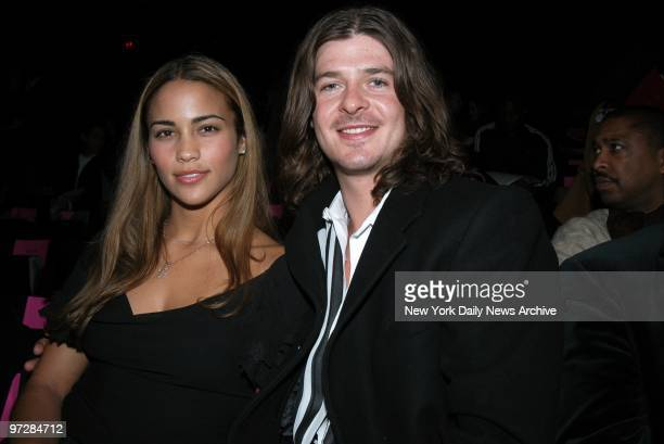Singer Robin Thicke and his girlfriend Paula Patton are on hand to see a showing of Baby Phat's Fall 2003 line at the Tent in Bryant Park on the last...