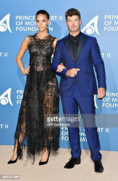 US singer Robin Thicke and his partner April Love Geary pose during the MonteCarlo Gala for the Global Ocean in Monaco on September 28 2017 / AFP...