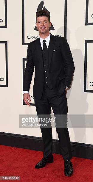 Singer Robin Thicke arrives on the red carpet during the 58th Annual Grammy Music Awards in Los Angeles February 15 2016 AFP PHOTO/ Valerie MACON /...