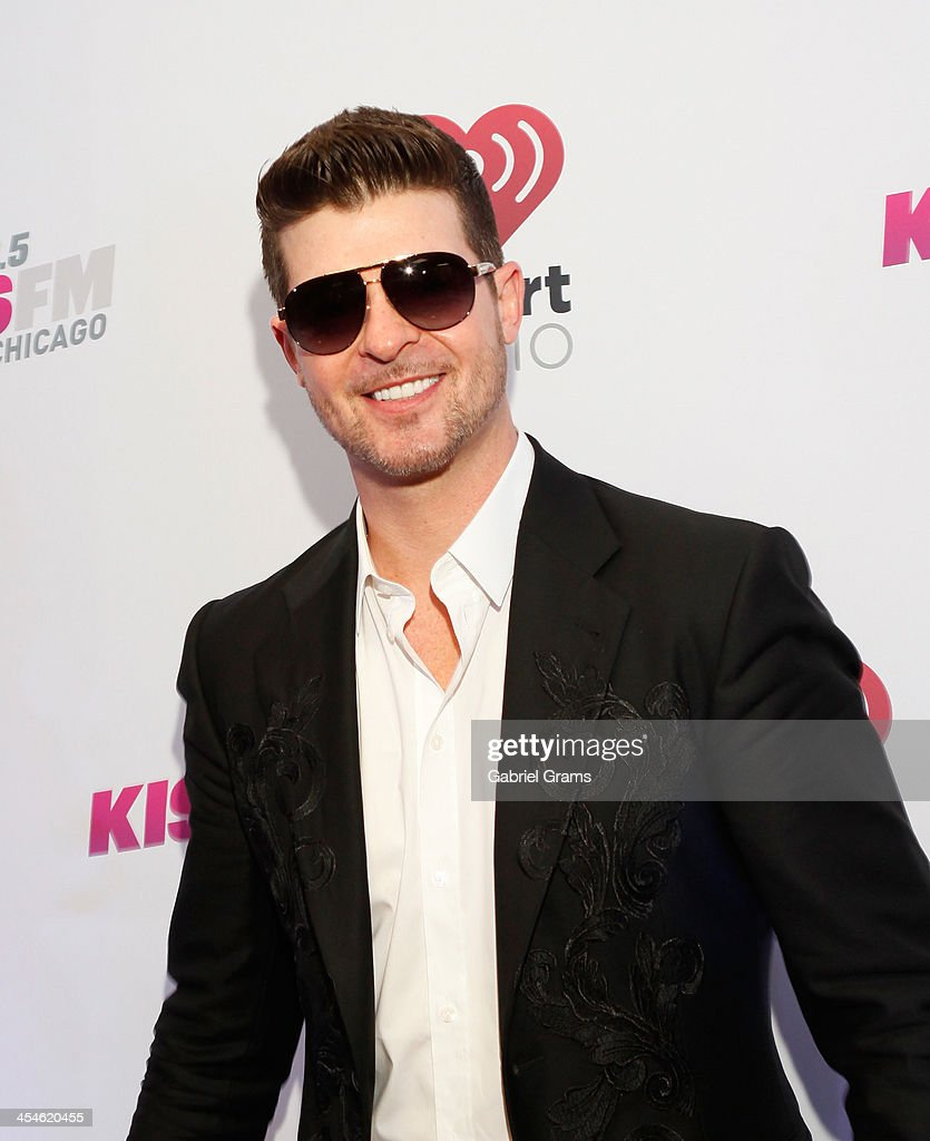 Singer Robin Thicke poses in the press room at 103.5 KISS FM's Jingle Ball 2013 at United Center on December 9, 2013 in Chicago, Illinois.