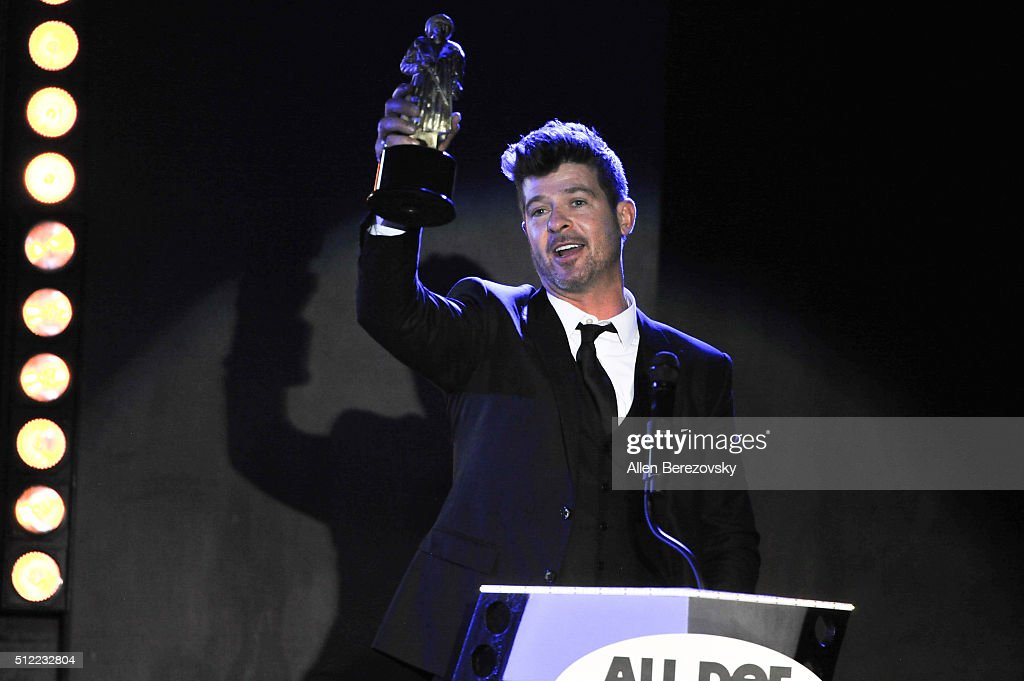 Singer Robin Thicke speaks onstage as he collects the Best Helpful White Person award on behalf of Christophe Waltz during the All Def Movie Awards at Lure Nightclub on February 24, 2016 in Los Angeles, California.