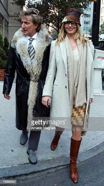 Singer Rod Stewart and companion Penny Lancaster walk along Madison Avenue after eating at La Goulue restaurant November 8 2002 in New York City