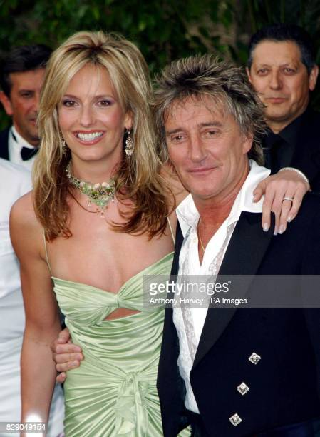 Singer Rod Stewart and his girlfriend Penny Lancaster arrive for the amfAR 'Cinema Against AIDS 2004' party at the Le Moulin de Mougins restaurant as...