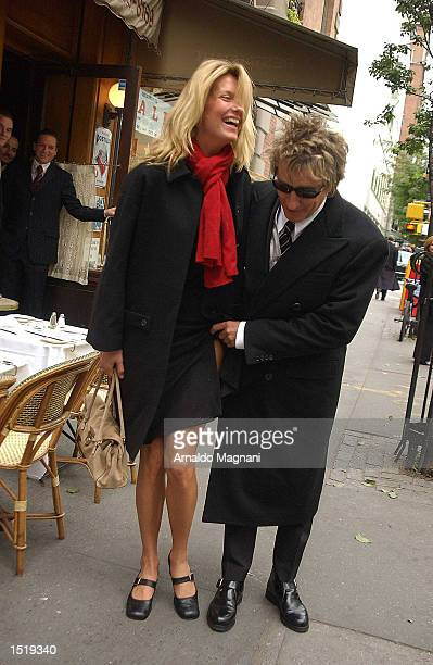 Singer Rod Stewart clowns around with fiance Penny Lancaster after leaving the restaurant La Goulue October 24 2002 at 66th Street and Madison Avenue...