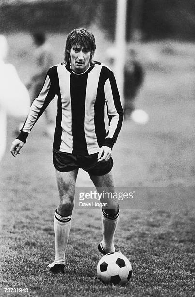 Singer Rod Stewart playing football in a striped shirt possibly of Brentford FC early 1980s
