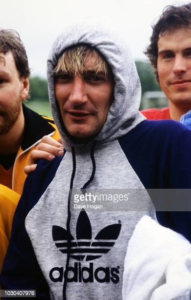 Singer Rod Stewart wearing an Adidas hooded tracksuit top 1983