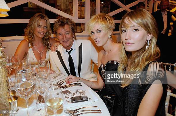 Singer Rod Stewart with daughters Kimberley, wearing a diamond drop earrings set with 2 beautiful brilliant cut diamonds , a bangle bracelet entirely...