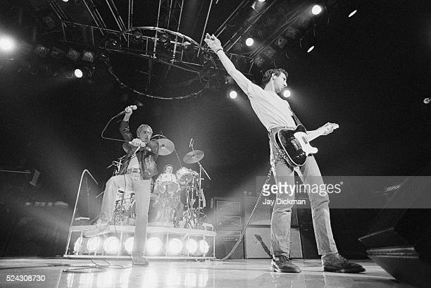 Singer Roger Daltrey and guitarist Pete Townshend of the rock band The Who perform in concert, circa 1970.