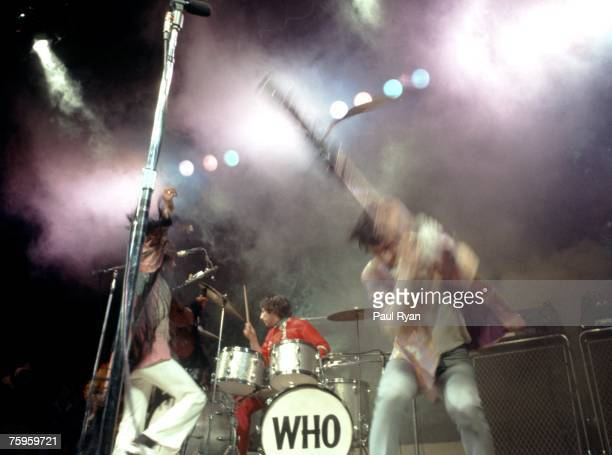 Singer Roger Daltrey bassist John Entwistle guitarist Pete Townshend and drummer Keith Moon the rock and roll band 'The Who' perform on stage at the...