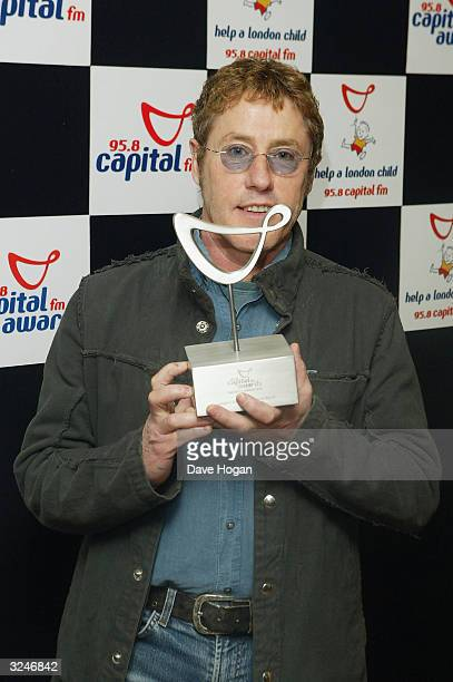 Singer Roger Daltrey from The Who, who collected an award for Outstanding Contribution to music on behalf of the band, poses in the awards room at...