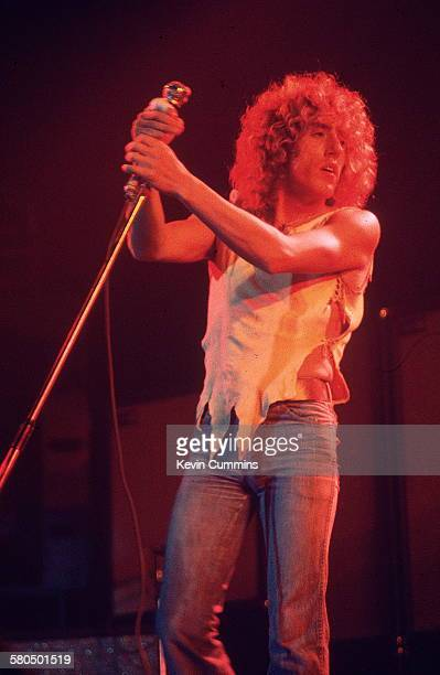 Singer Roger Daltrey performing with English rock group The Who at Belle Vue Manchester October 1975