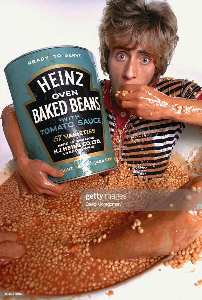 Singer Roger Daltrey sitting in a bathtub filled with baked beans, in a spoof advertisement for the cover of the album 'The Who Sell Out', 1967.