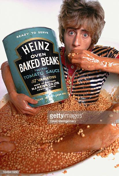 Singer Roger Daltrey sitting in a bathtub filled with baked beans in a spoof advertisement for the cover of the album 'The Who Sell Out' 1967