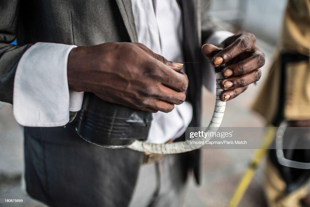 Singer Roger Landu of Staff Benda Bilili are photographed for Paris Match on August 27, 2013 in Kinshasa, Democratic Republic of Congo.