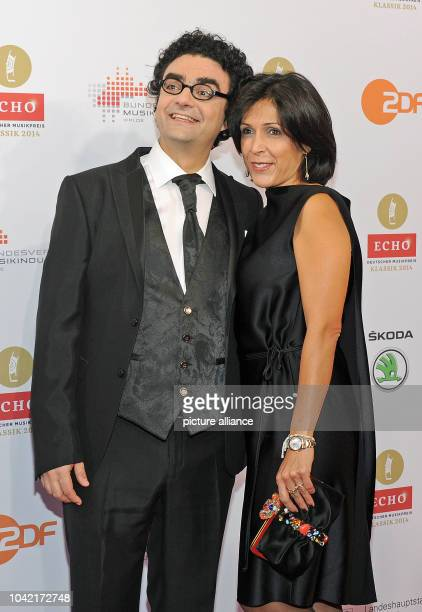 Singer Rolando Villazon and his wife Lucia arrive to the 'Echo Klassik' music award ceremony at the Philharmonic Hall in Munich Germany 26 October...