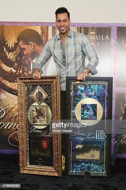 Singer Romeo Santos poses with a gold disc for more than 30000 copies sold of his album Romeo Santos The King Stays King and gold disc for more than...