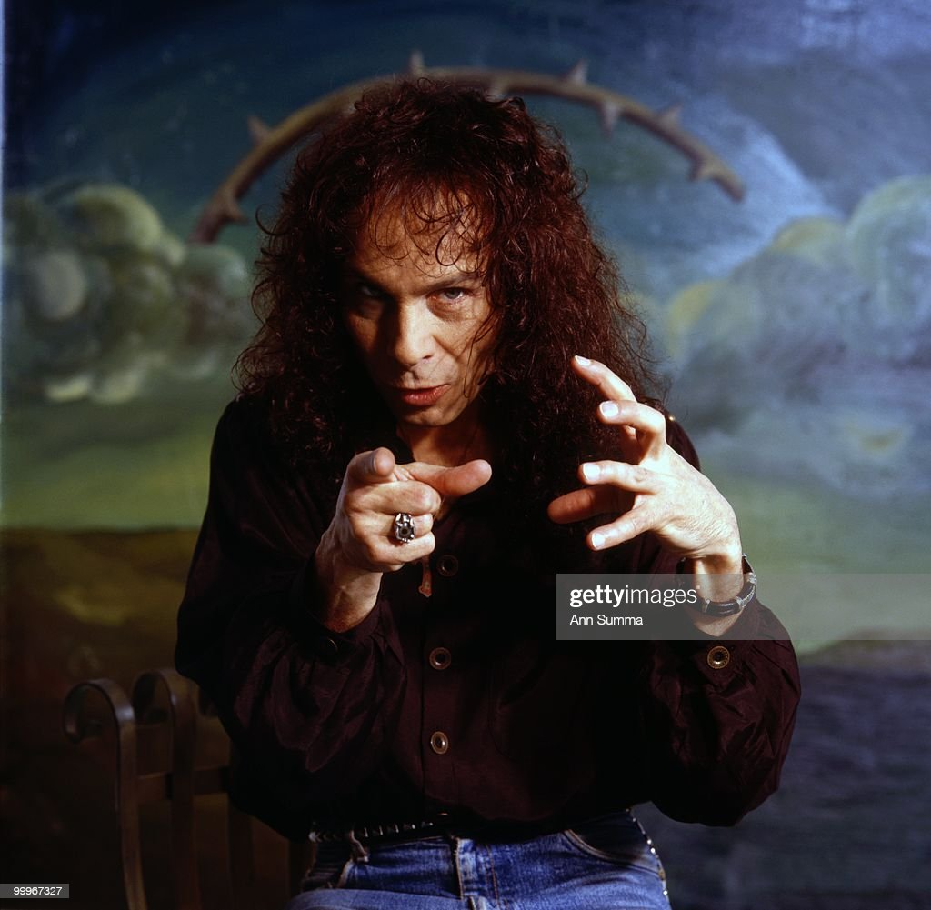 Singer Ronnie James Dio poses for a portrait in front of a painting by Manuel Ocampo on April 10, 1990 in Los Angeles, California.