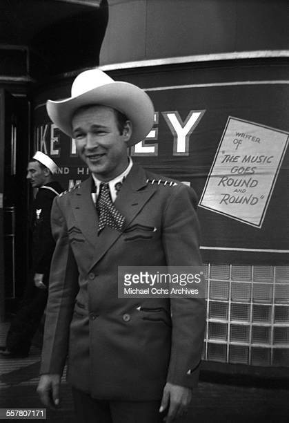 Singer Roy Rogers poses on a street in Los Angeles California