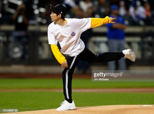 Singer Roy Wang throws the ceremonial first pitch of a game between the New York Mets and the Miami Marlins at Citi Field on September 28 2018 in the...
