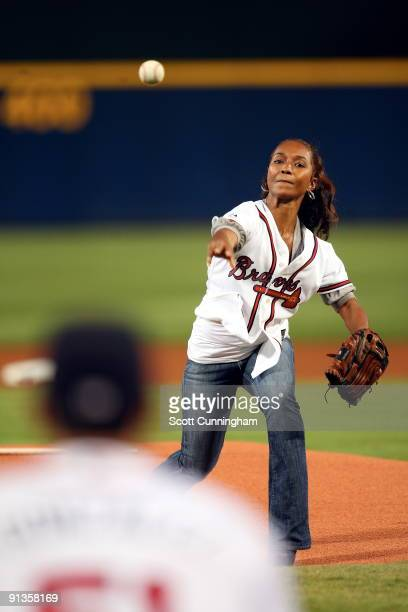 Singer Rozonda 'Chilli' Thomas throws out the first pitch before the game between the Atlanta Braves and the Washington Nationals at Turner Field on...