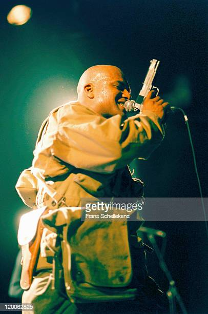 Singer RudeBoy Remmington of Urban Dance Squad performs live on stage holding a gun at the Melkweg in Amsterdam, Netherlands on 15th May 1999.