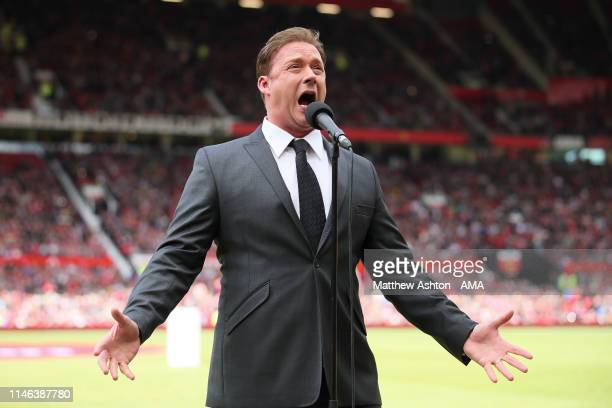Singer Russell Watson entertains the crowd prior to the Manchester United '99 Legends v FC Bayern Legends match at Old Trafford on May 26 2019 in...