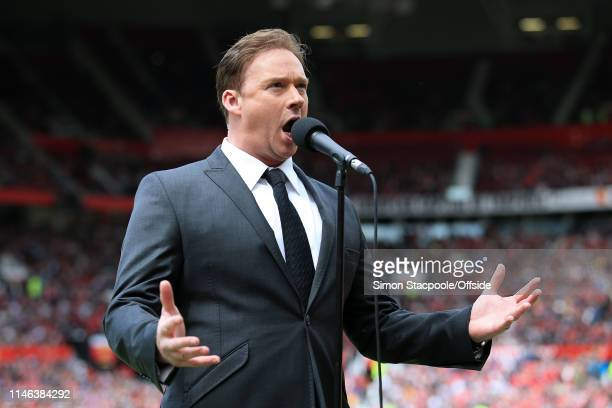 Singer Russell Watson performs before the Treble Reunion friendly match between the Manchester United '99 Legends and FC Bayern Legends at Old...