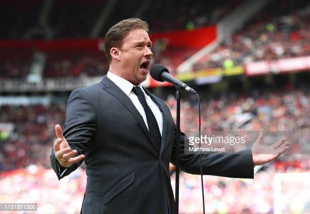 Singer Russell Watson sings ahead of the Manchester United '99 Legends and FC Bayern Legends match at Old Trafford on May 26 2019 in Manchester...