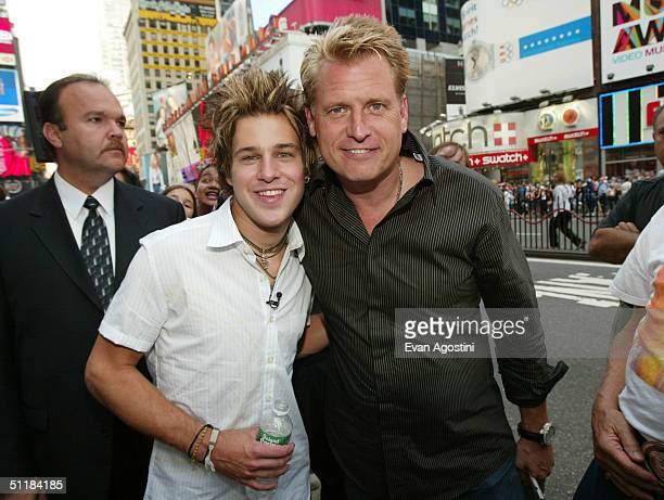 Singer Ryan Cabrera poses with manager Joe Simpson during MTV's Total Request Live at MTV Studios Times Square August 17, 2004 in New York City.