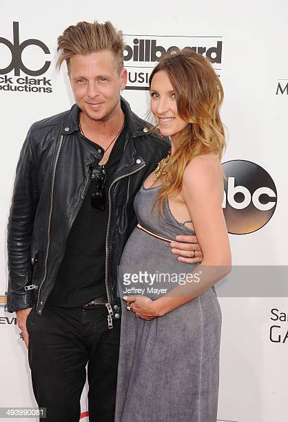 Singer Ryan Tedder of One Republic and wife Genevieve Tedder arrive at the 2014 Billboard Music Awards at the MGM Grand Garden Arena on May 18 2014...