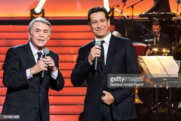 Singer Salvatore Adamo and impersonator Laurent Gerra impersonating Adamo perform during the live broadcast on public channel France 2 of the program...