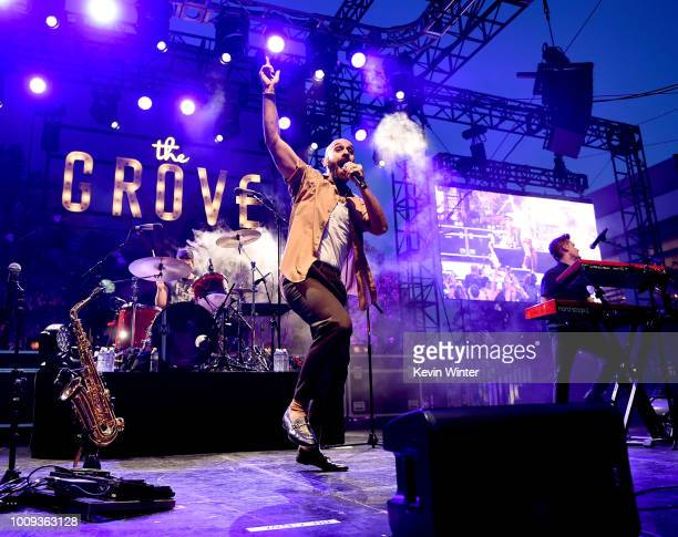 Singer Sam Harris Adam Levin drummer and Casey Harris keyboards of the X Ambassadors perform at The Grove's 2018 Summer Concert Series presented by...